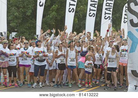 Color Run Racers Reach To Catch Prizes At The Starting Line