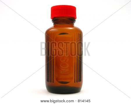 small poison bottle with red cap