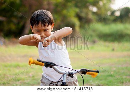 happy young asia boy  playing kungfu having fun