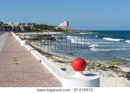 ISLA MUJERES - JANUARY 21: Tourists enjoy the sunny weather and walking on the promenade on 21 January 2015 in Isla Mujeres, Mexico. The island is located 8 miles east of Cancun in the Gulf of Mexico.