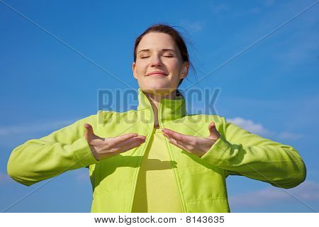 Woman Doing Breathing Exercises Outdoors