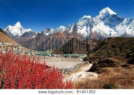 view of Khumjung village and beautiful himalayas near Namche bazar Ama Dablam kangtega and Thamserku - Way to Everest base camp - Nepal poster