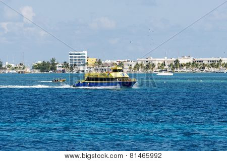 ISLA MUJERES - JANUARY 21: Ferry boat with tourists on 21 January 2015 in Isla Mujeres, Mexico. The island is located 8 miles east of Cancun in the Gulf of Mexico.
