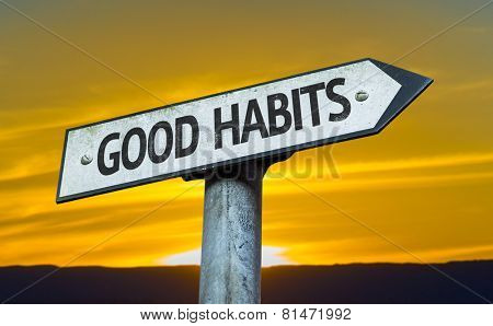 Good Habits sign with a sunset background