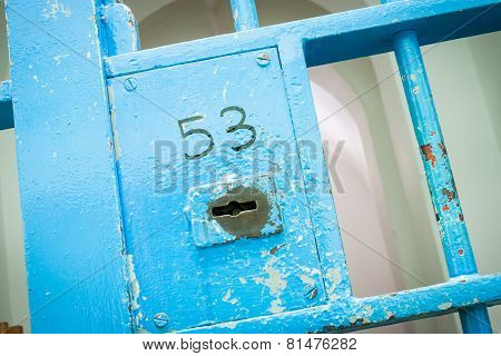 Blue lock in old prison. Lock number 53. poster
