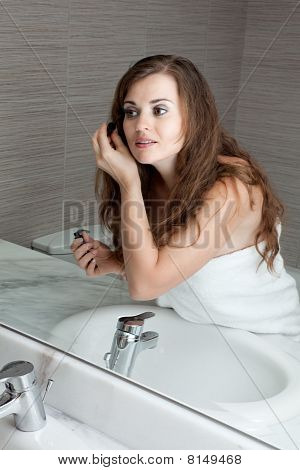 gorgeous woman makeup in bathroom