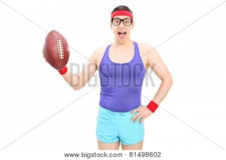 Excited nerdy guy holding a football isolated on white background