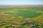 Ballooning over Israel - bird's eye view of farm lands and hills near Tel Aviv after the rain seen from a hot air balloon poster