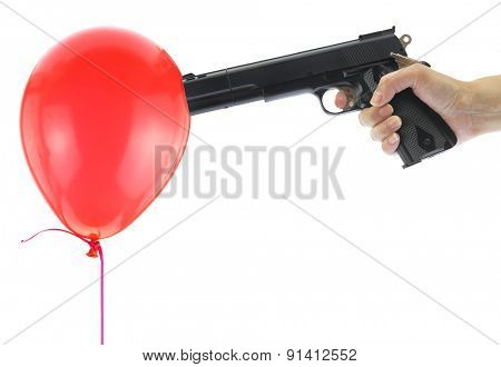 Hand holding at gunpoint a red balloon isolated on white