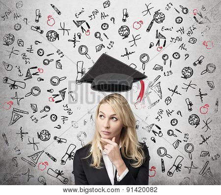A Lady Is Pondering Over The Advantages Of Education. A Concept Of The Further Business Education.