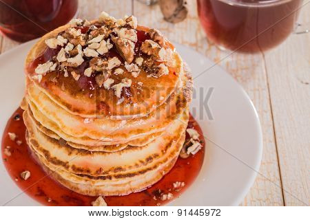 Homemade Pancakes With Walnuts And Strawberry Jam