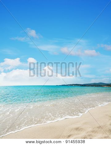 Le Bombarde Beach Under A Blue Sky With Clouds