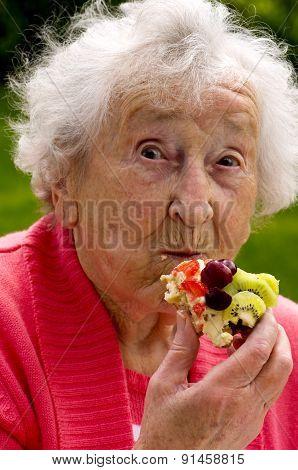 Senior Lady Eating A Waffle