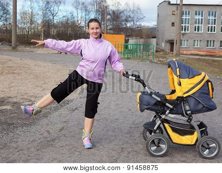 Young Mother Is Engaged In Fitness In A Stadium