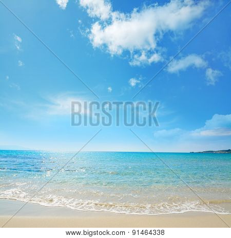 Le Bombarde Shoreline Under A Blue Sky
