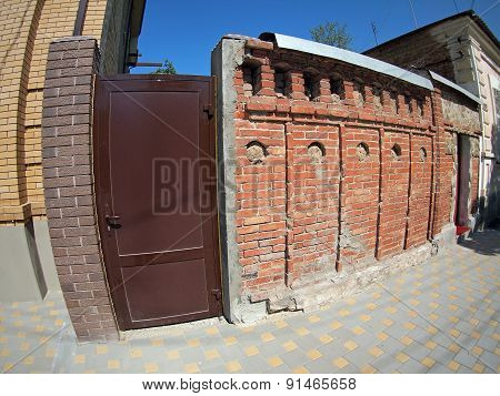 Brick Wall With A Solid Metal Door In A City Street