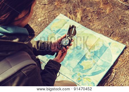 Traveler Holding A Compass In The Forest
