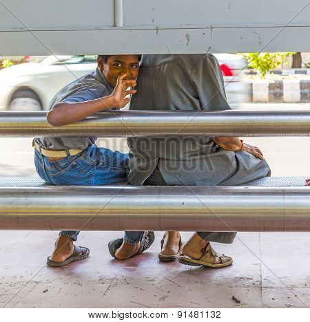 Boy Waits For The Bus At The Busstop