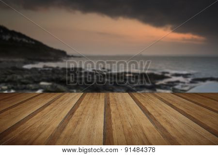 Sunrise At An Ocean In Spring On England's Cornwall Coast With Wooden Planks Floor