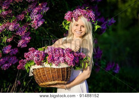 Beautiful Smiling Young Woman Is Wearing Wreath And Basket Of Li