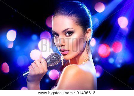 Beautiful Singing Girl. Beauty Glamor fashion Woman with Microphone over Blinking bokeh night background. Glamour Model Singer. Karaoke song. Karaoke party poster