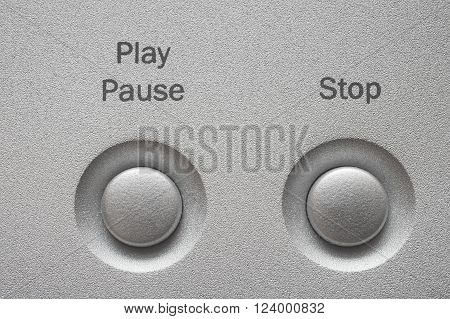 Aluminum buttons for a CD or DVD player.