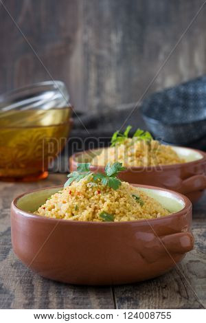 Homemade Couscous with vegetables on rustic wood ** Note: Shallow depth of field