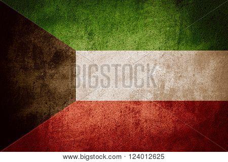 flag of Kuwait or Kuwaiti banner on rough pattern background