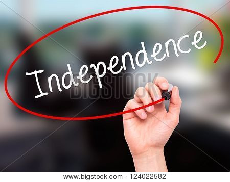 Man Hand Writing Independence  With Black Marker On Visual Screen.