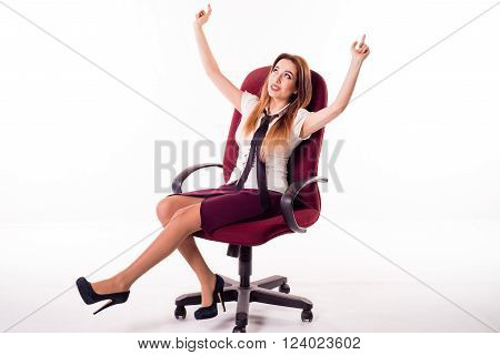 Happy business woman scrolls sitting on a chair, his hands holding the top