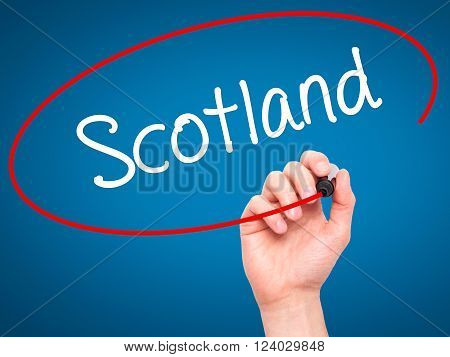 Man Hand Writing Scotland With Black Marker On Visual Screen.