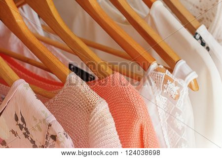 collection of women's clothes hanging on a rack