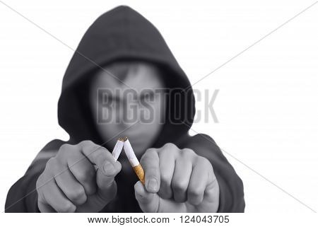 A young man leaves off smoking on a white background.