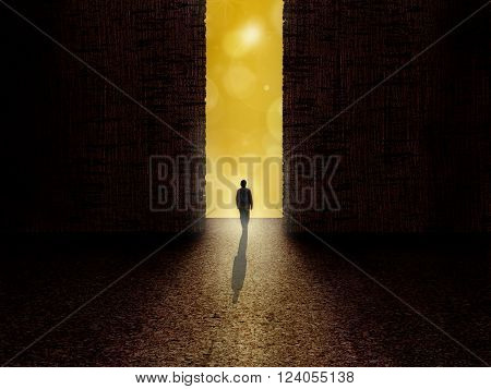 Man standing at the border of darkness and light