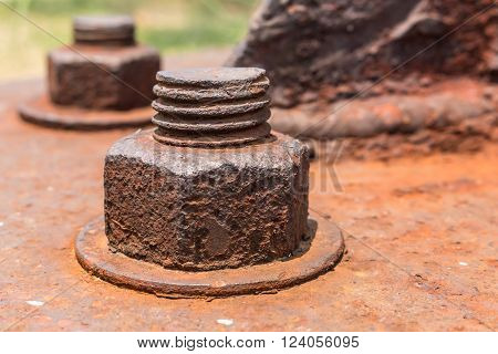 Old rusty metal nuts locked with rust and corrosion old bolts. Close up.