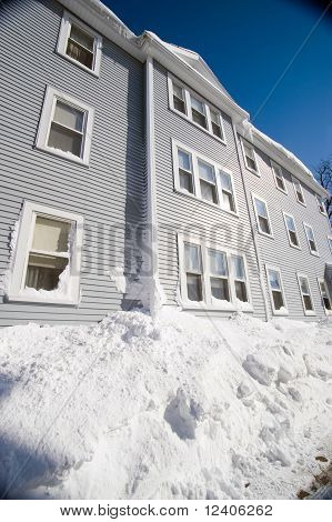 Blue Three Story House In Winter