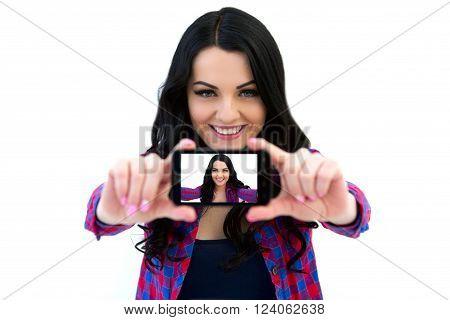 Portrait Of Cute Woman Making Selfie Photo On Smartphone