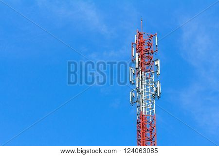 Cell phone tower or Telecommunication tower with blue sky for background and design with copy space for text or image.