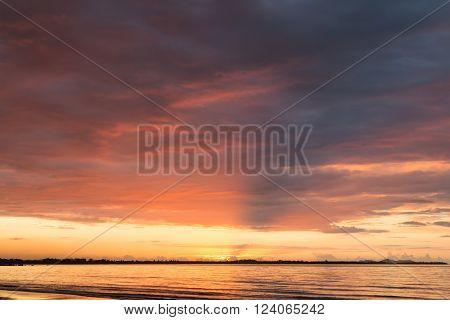 Pink sunset on the ocean beach. Fiji.