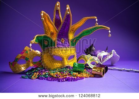 Festive Grouping of mardi gras venetian or carnivale mask on a purple background