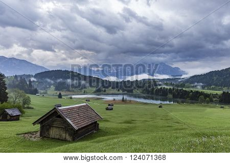 View on Geroldsee in Bavaria from a hill with heavy clouds in the sky