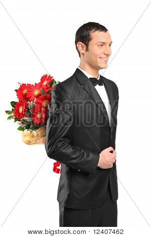 Man Hiding A Bouquet Of Flowers Behind His Back
