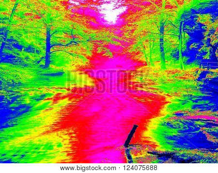 Mossy boulder and water level in shadows of trees. Cold water of mountain river in infrared photo. Amazing thermography.