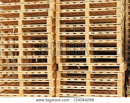 Texture of wooden euro pallets stocked in high column
