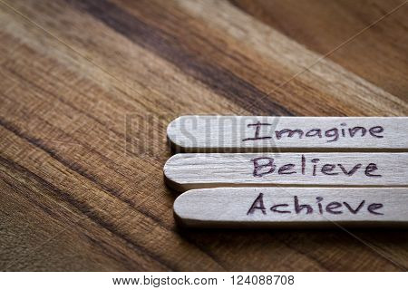 Self esteem building concept using plain popsicle sticks with a hand written positive or motivating message