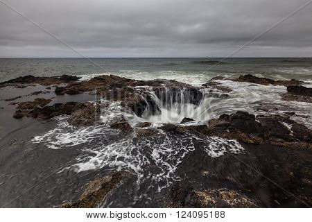 Feature known as Thor's Well in the central Oregon coast with a drama and natural wonder