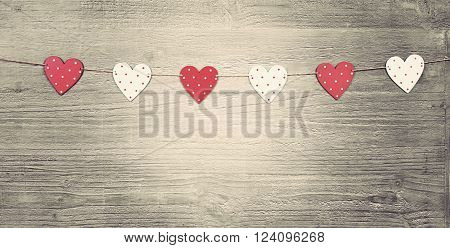 Valentines Day hearts on vintage wooden background as Valentines Day  symbol.Toned in vintage style
