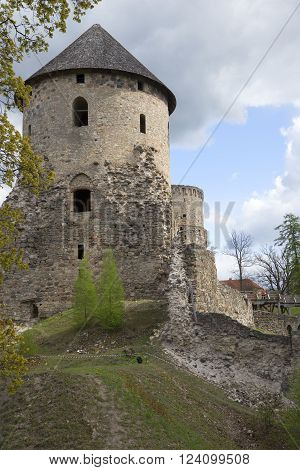CESIS, LATVIA - MAY 03, 2014: The tower of a medieval castle cloudy may afternoon. The historic landmark of the city of Cesis, Latvia