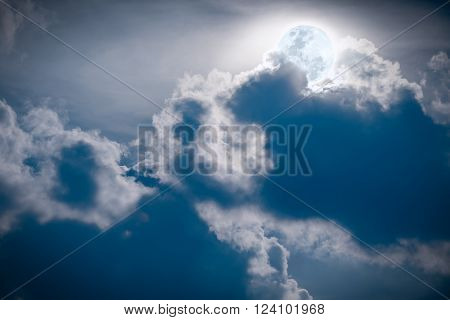 Attractive photo of a nighttime sky with clouds bright full moon would make a great background. Nightly sky with large moon.