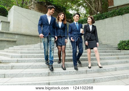 Group of business people walking down the stair case